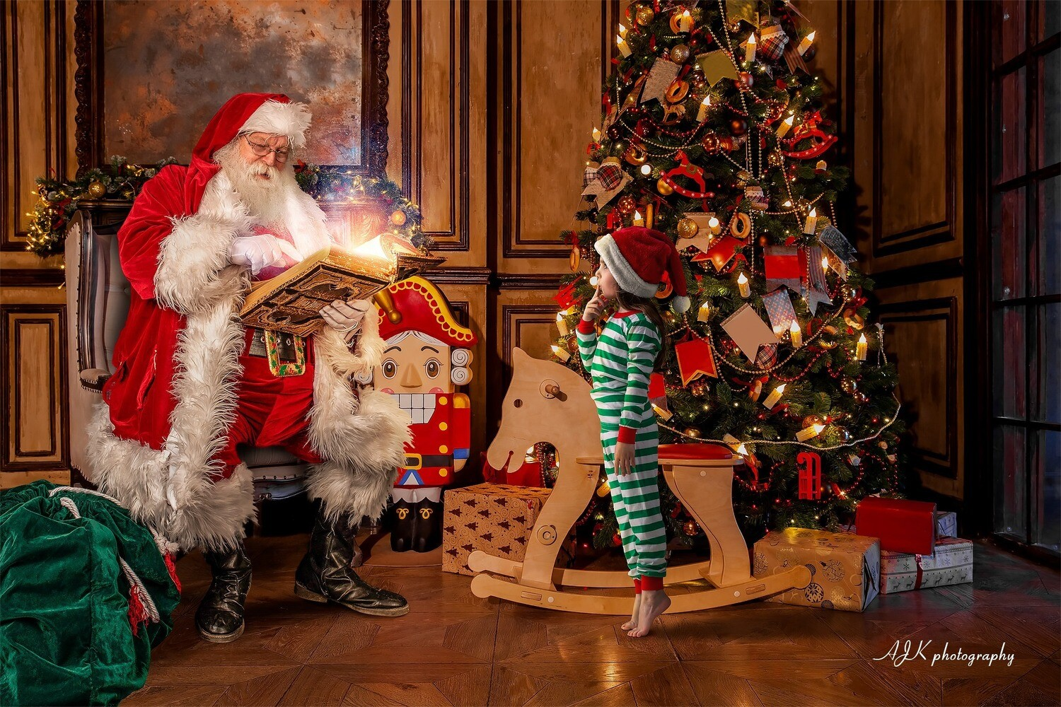 Santa in Chair in Warm Room Reading by Fireplace with Rocking Horse - Santa with Scroll - The Good List - Christmas Holiday Digital Background Backdrop