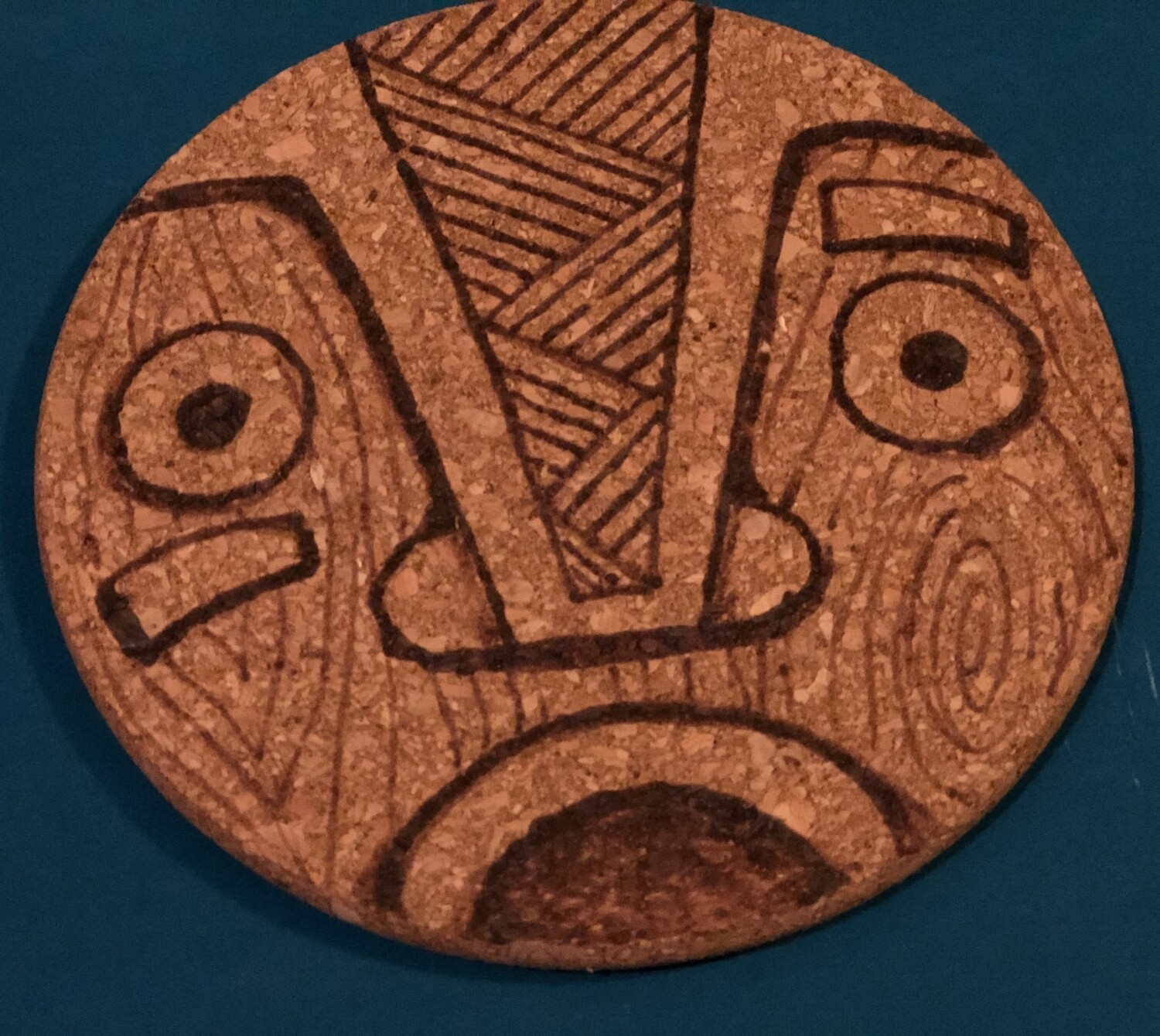 Wood-burned Cork Trivet, Tiki (Shock 3)