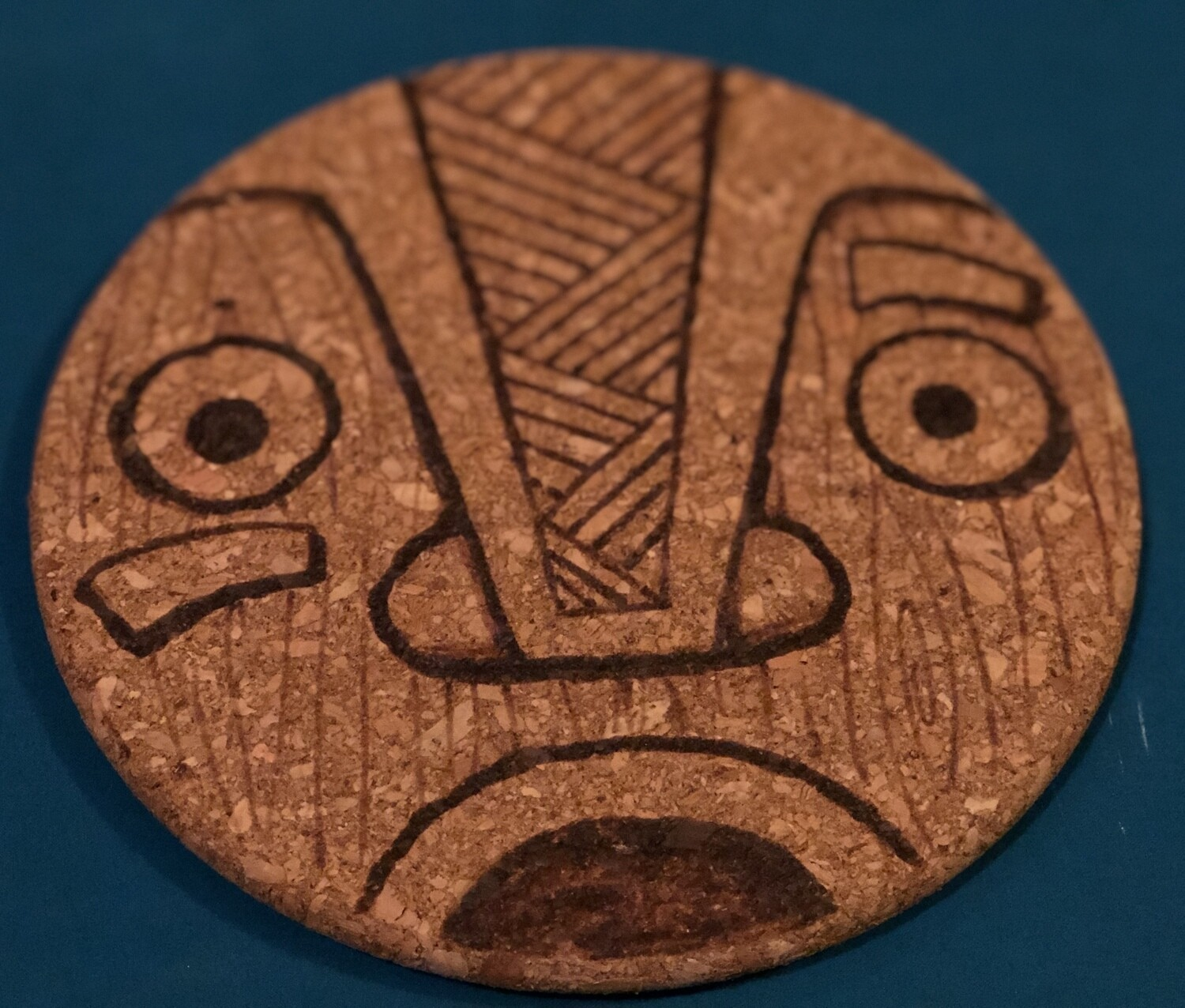 Wood-burned Cork Trivet, Tiki (Shock 1)