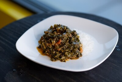 Chopped Collard greens with tomatoes and rice