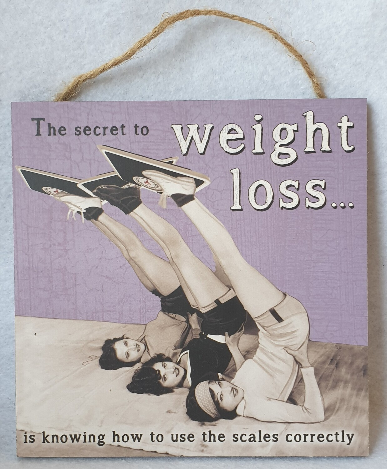 Funny weight loss wall plaque.
