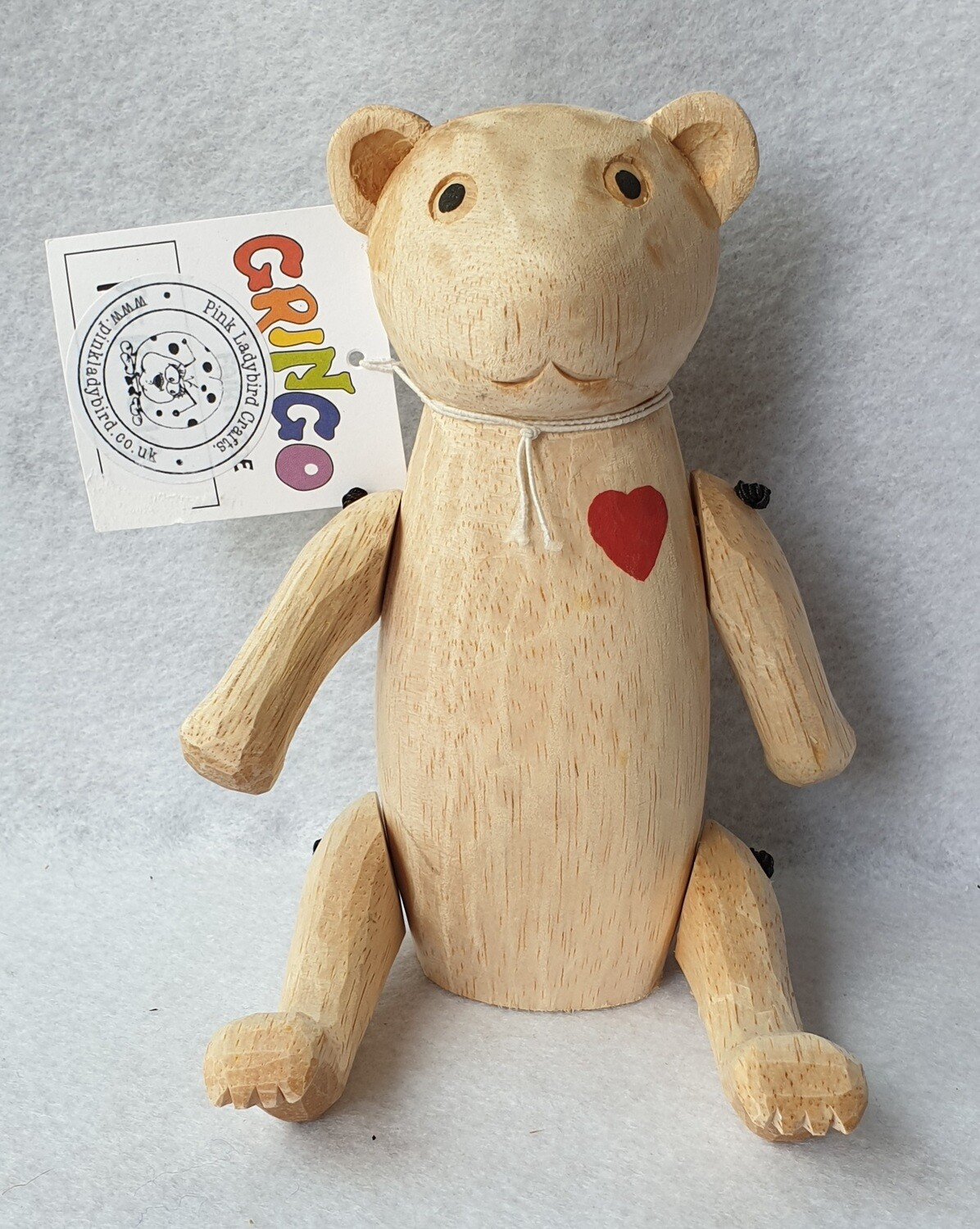 Gringo hand carved, jointed, wooden bear.