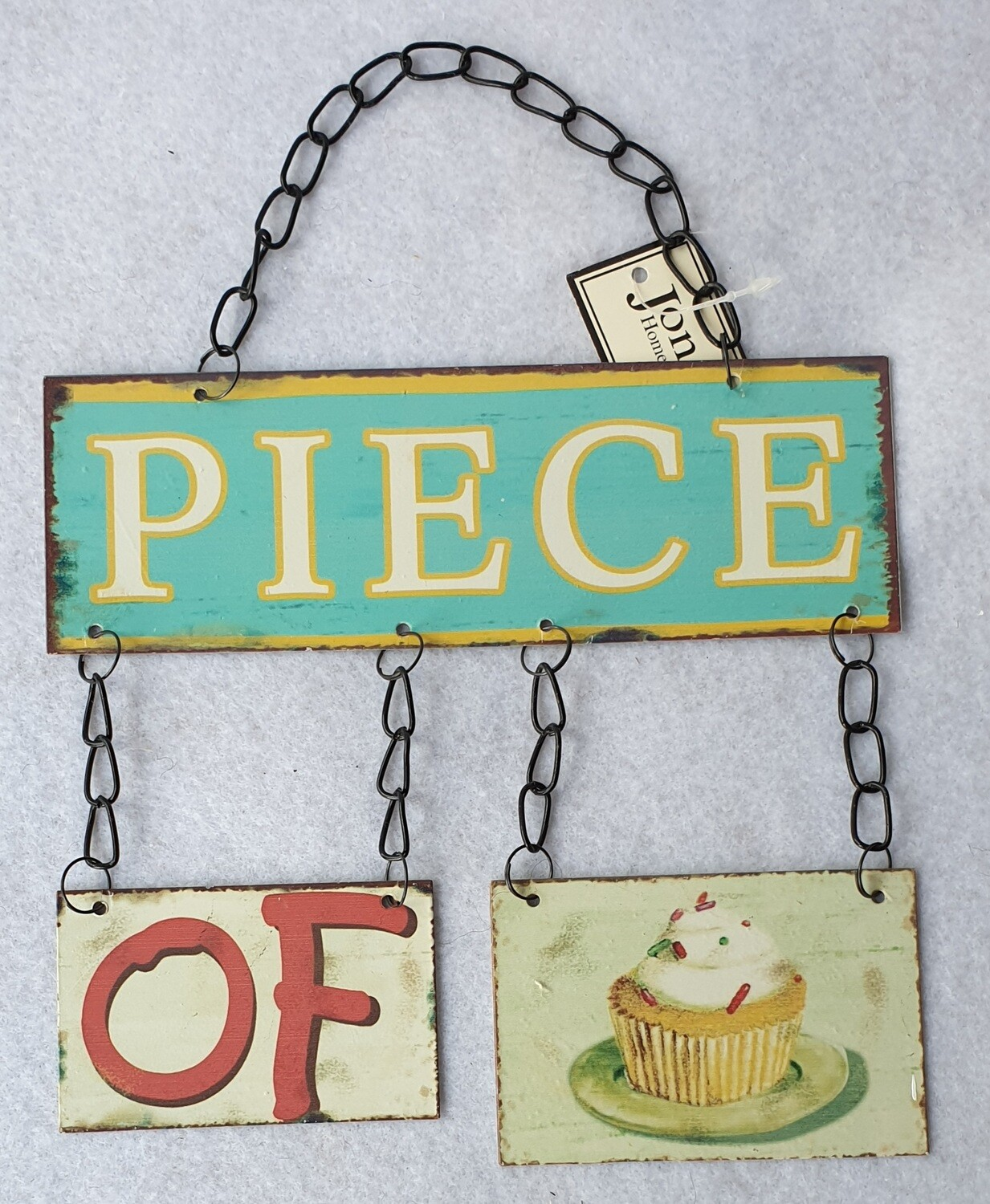 'Piece of cake' metal wall decoration.