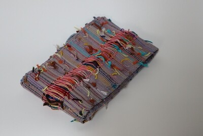 Table runner or scarf made with reused materials