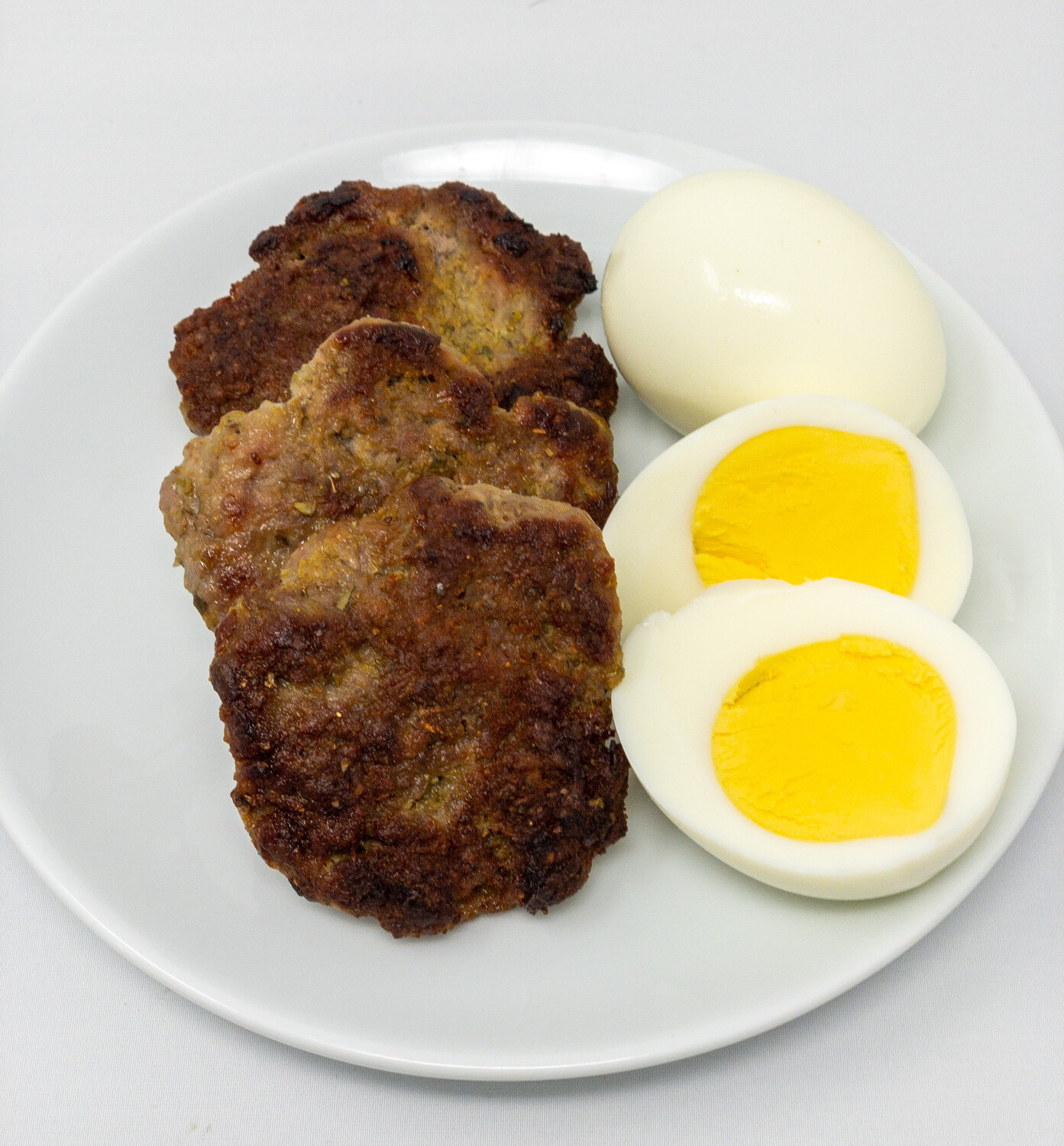 Breakfast Sausage Patties With Hard boiled Eggs