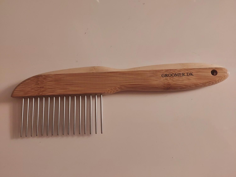 DETANGLER ''Long teeth'' comb with rotating teeth