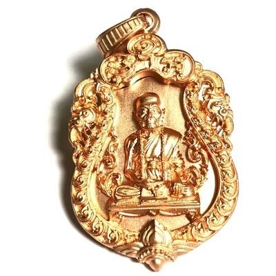 Rian Sema Chalu Lai Ganok Ongk Sadung Glab (Pink Gold plating) - 2554 BE - Luang Phu Kam Bu (Wat Gut Chompoo) - 3 -piece riveted Buddhist Monk Coin amulet