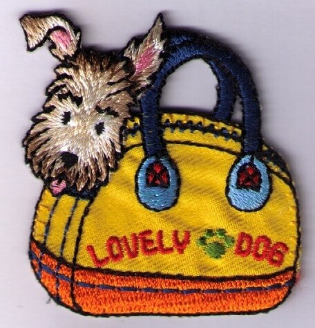 Applicatie hond in tas