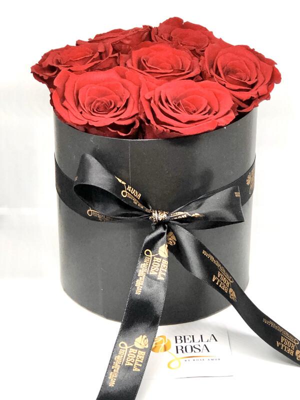 Caja redonda con 7 rosas preservadas Q495