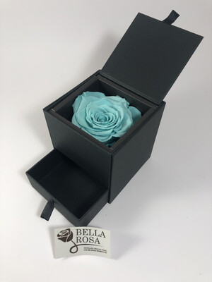 Caja acrílica con rosa natural preservada en color turquesa