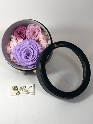 Caja redonda de cuerina con tres rosas preservadas
