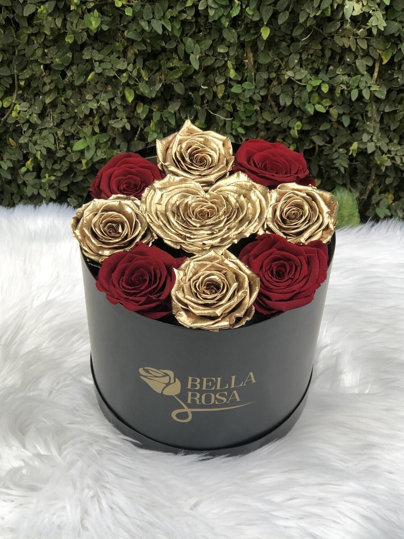 Caja redonda, blanca o negra con 8 rosas y una rosa en forma de corazon