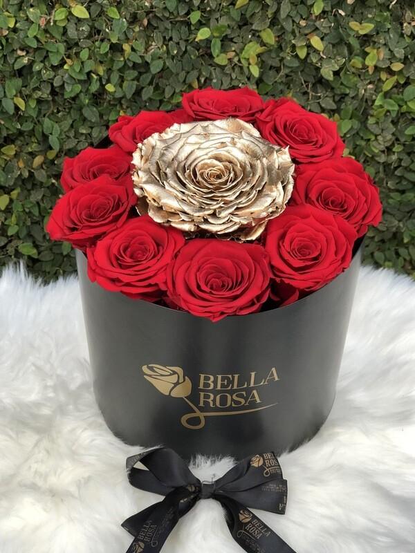 Caja redonda, blanca o negra con 9 rosas LL y una Xl