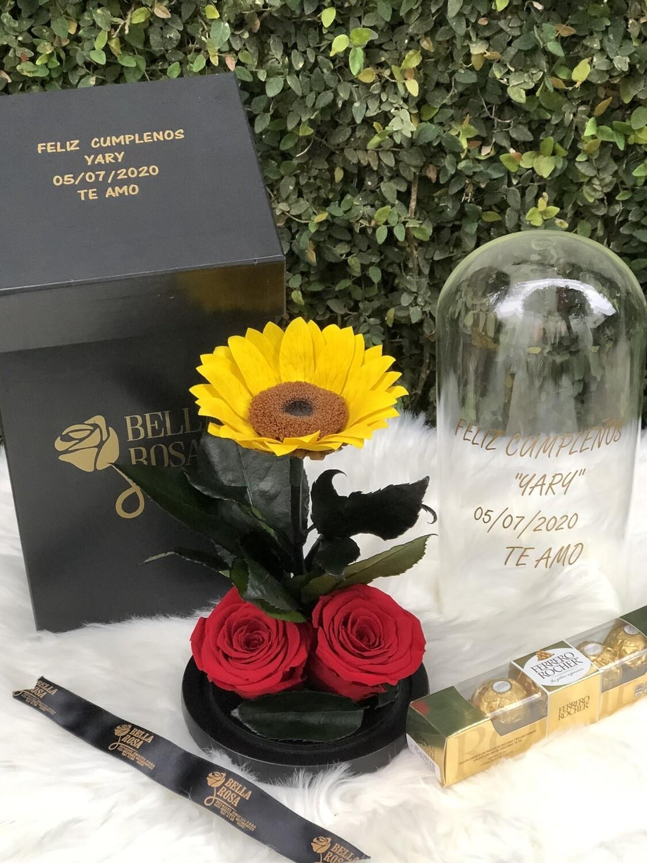 Cúpula de cristal de 25 cm de alto con 1 girasol preservado y 2 rosas, personalizado y caja de chocolates Ferrero.