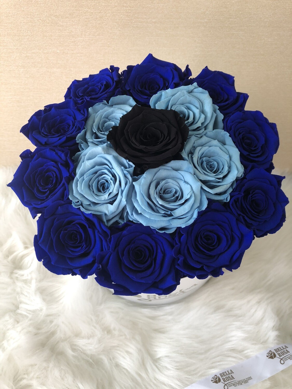 Caja redonda con 16 rosas naturales preservadas
