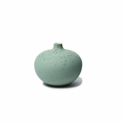 Vase vert tacheté