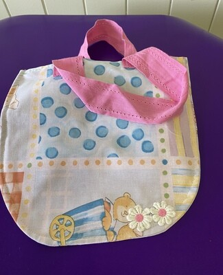 Colourful tote bag with pink ribbon handles