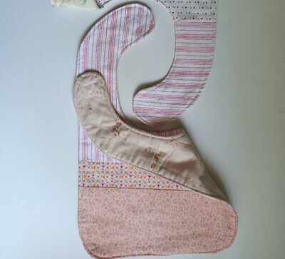 Floral and striped Bib in pink tones, 2 sided, velcro fastening, material (ref # 40)