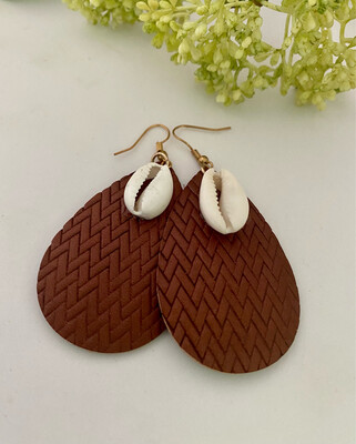 Cowrie Shell On Leather