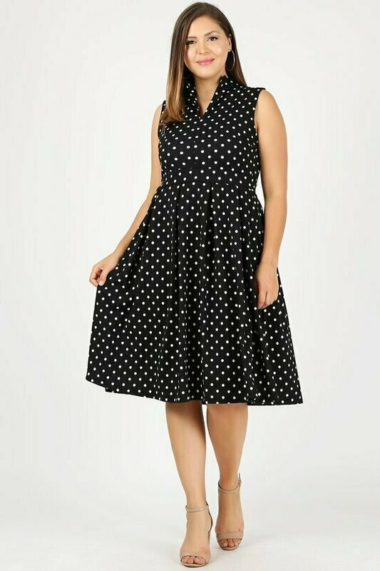 Pleasant Sleeveless polka dot a-line dress with v-neckline, fold over collar, banded waist, and pleated skirt detail.