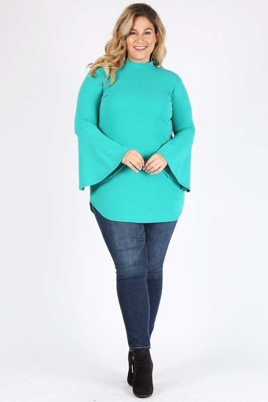 Solid long sleeve top with mock neckline, bell sleeves, and pockets.