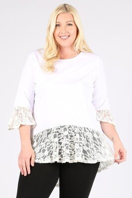 Solid top with lace contrast, a round neckline, and a hi-lo hem.