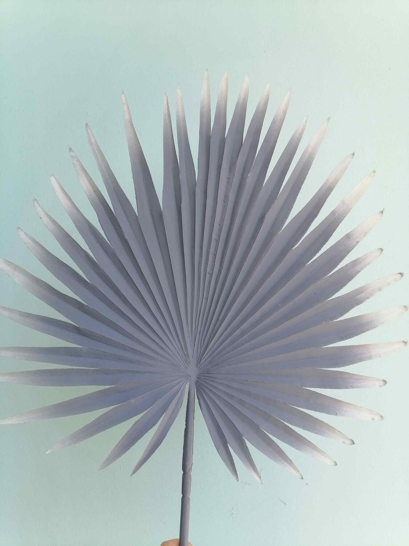 Palm leaf blur gray artificial