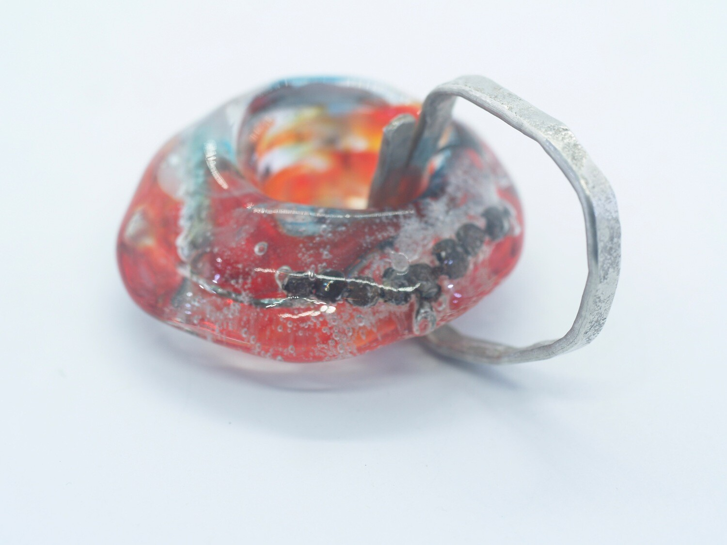 red handmade emubead with inclusions on silver