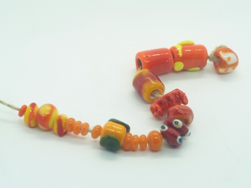 handmade mixed bundle dark orange emubeads