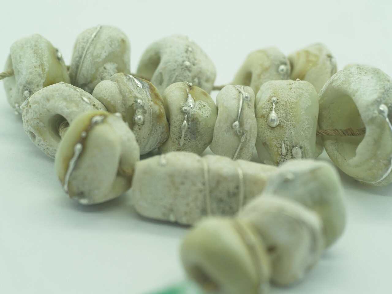 emubeads seawash ivory with silver design for jewellery making