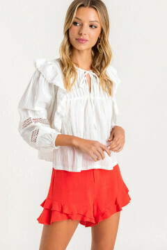 White ruffle peasant top