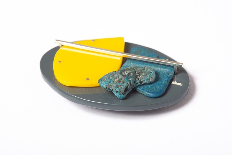 Found: Grey, Yellow and Blue Oval Brooch