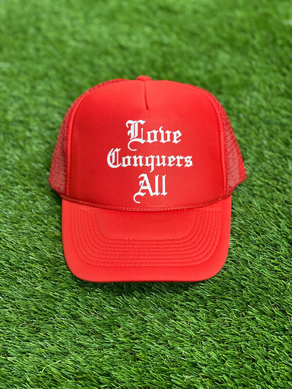 """Red """"Love Conquers All"""" Trucker Hat"""