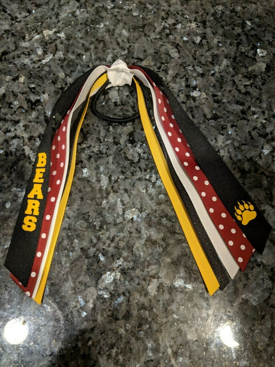 "Hair Ribbon #2 Black with ""bears"" written in yellow"