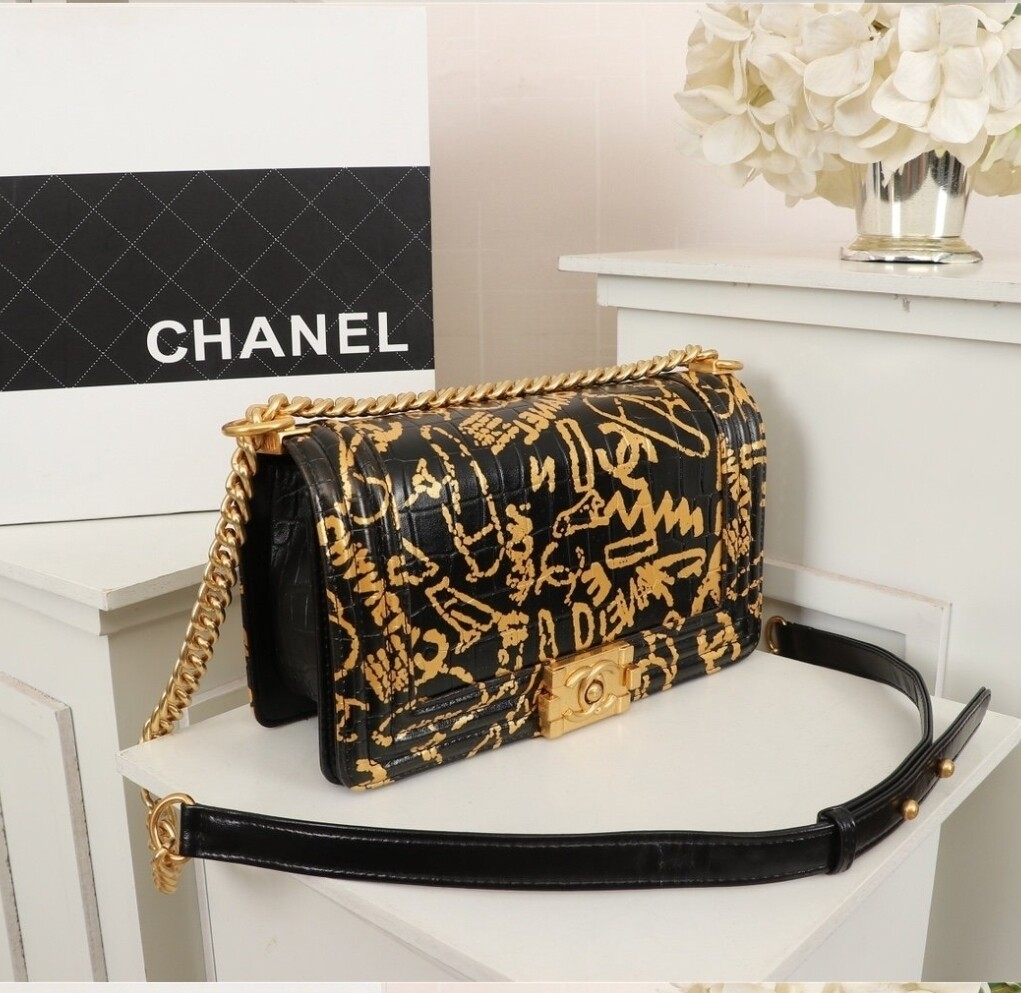 Chanel *Authentic Quality*  Black/Gold