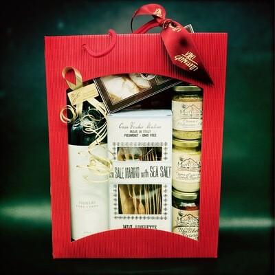 Geschenktragetasche gefüllt mit vielen Köstlichkeiten