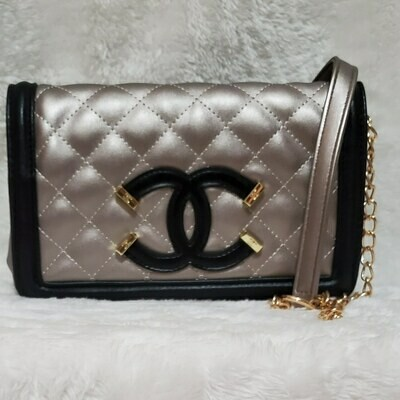 CHANEL (GOLD with BLACK trim)