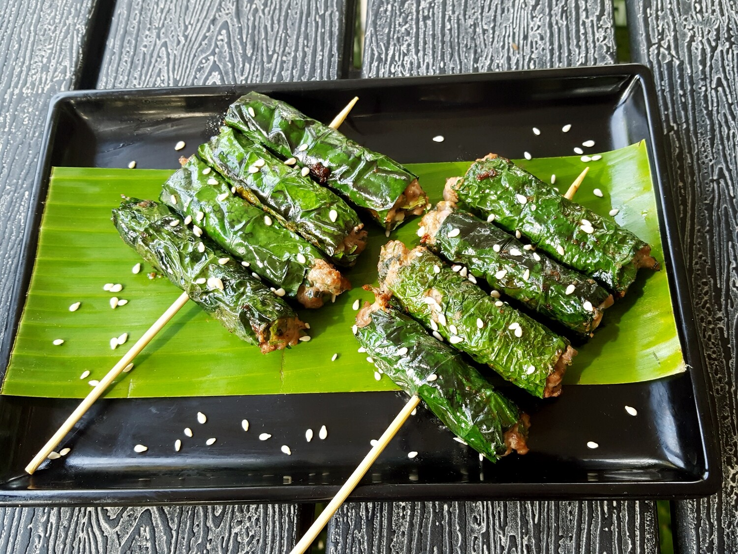 (BO NUONG LA LOT) Grilled beef wrapped in wild betel leaf