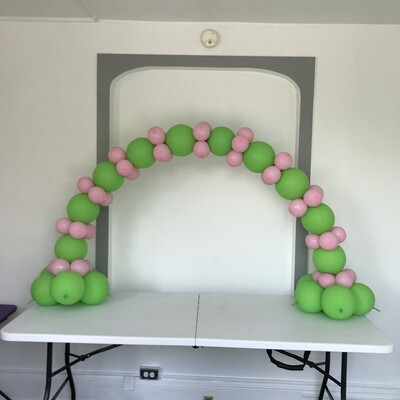 Air filled indoor table top link arch, indoors