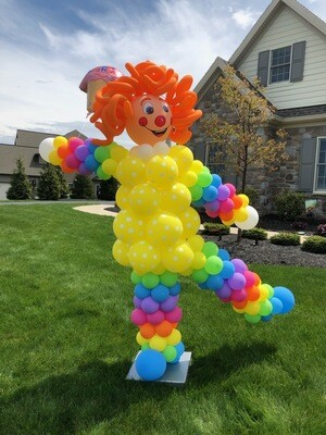 Giant clown column (outdoors, piercing earth)