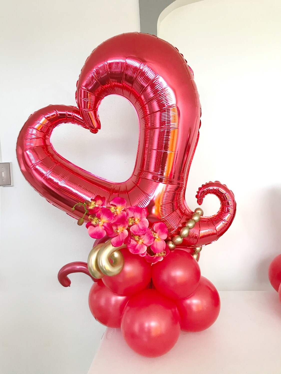 Giant open heart balloon bouquet with Orchid. Air filled.