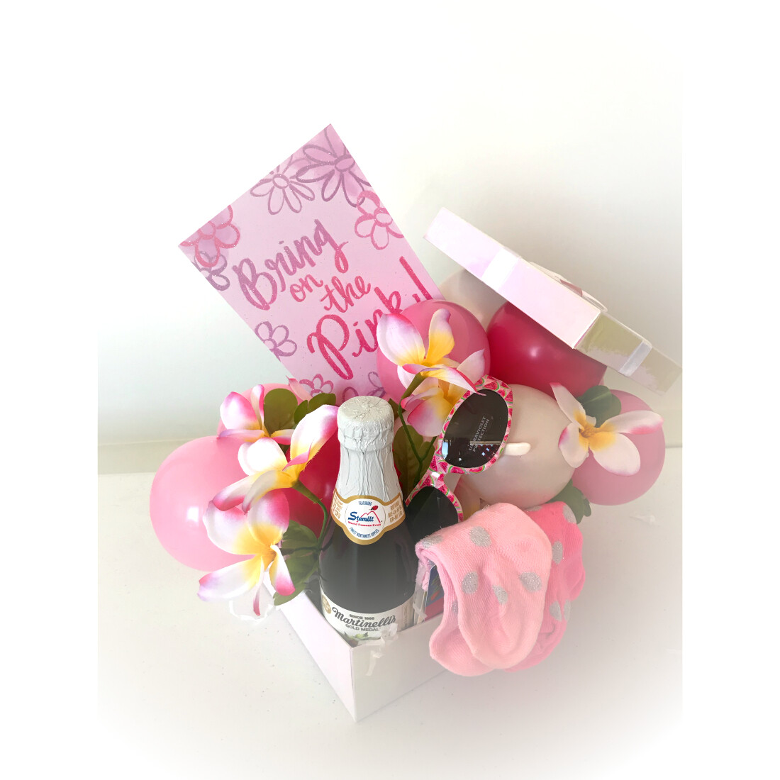 Gift box bursting with balloons, artist's choice of gifts