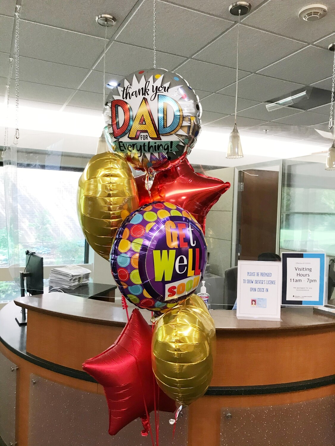 Get well soon custom balloon bouquet on strings with a weight (indoors)