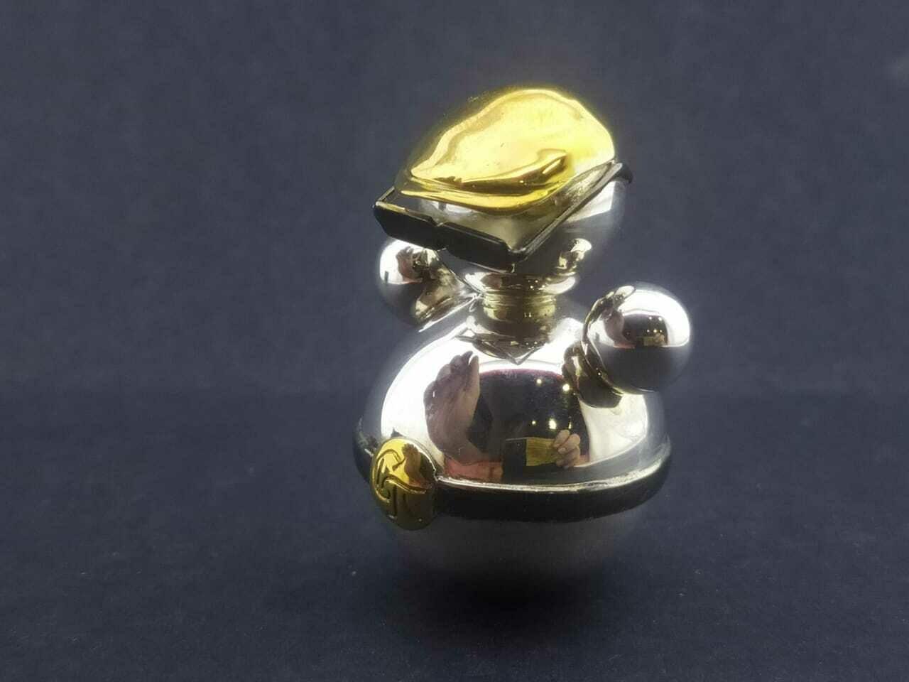 Неваляшки из золота и серебра