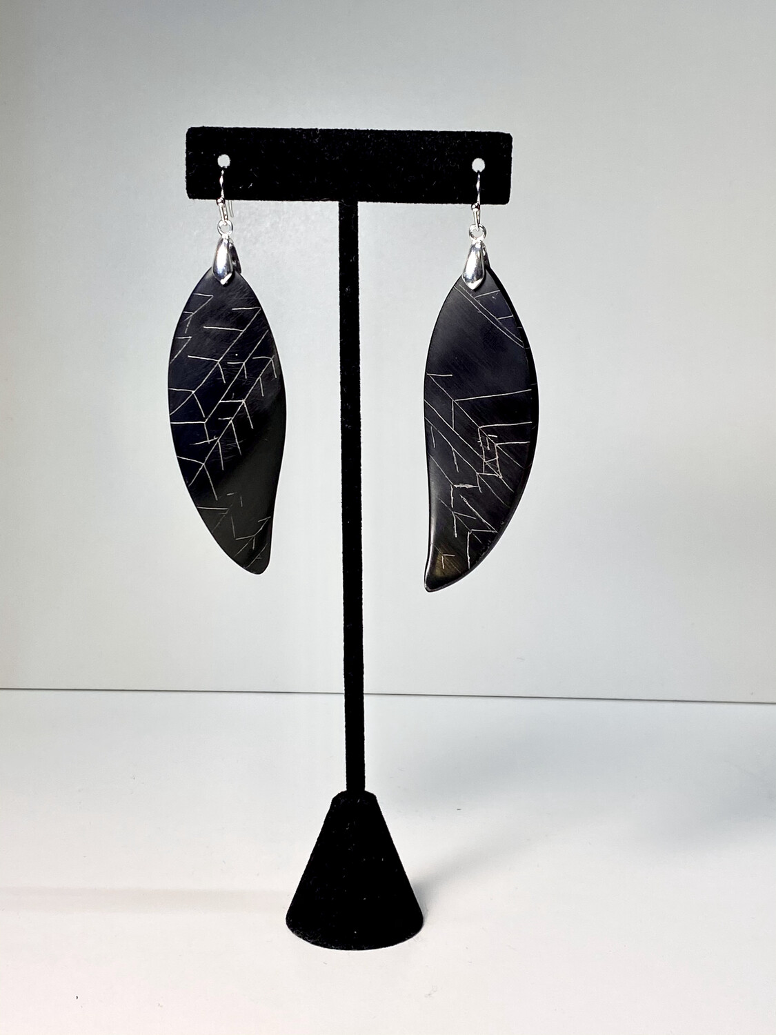 (7) Baleen and silver earrings