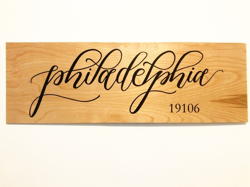 Town and zip code sign- wood background