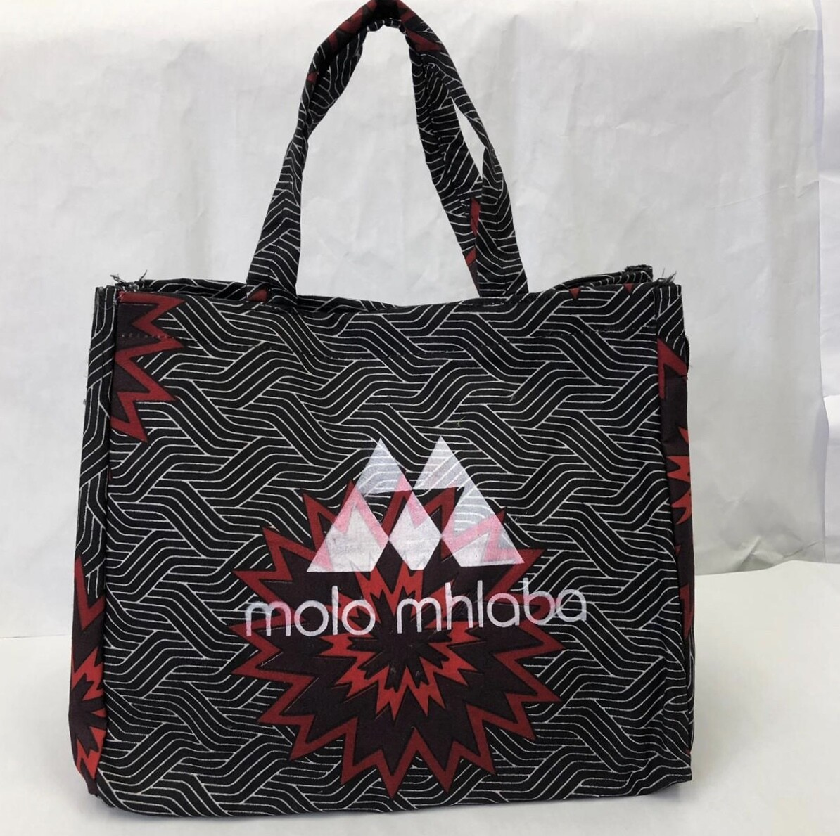Geometric red/black pattern handbag