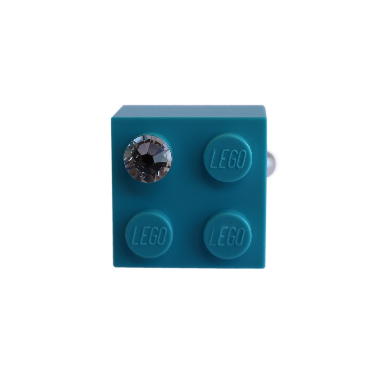 Turquoise Blue LEGO® brick 2x2 with a 'Diamond' color SWAROVSKI® crystal on a Silver plated adjustable ring finding