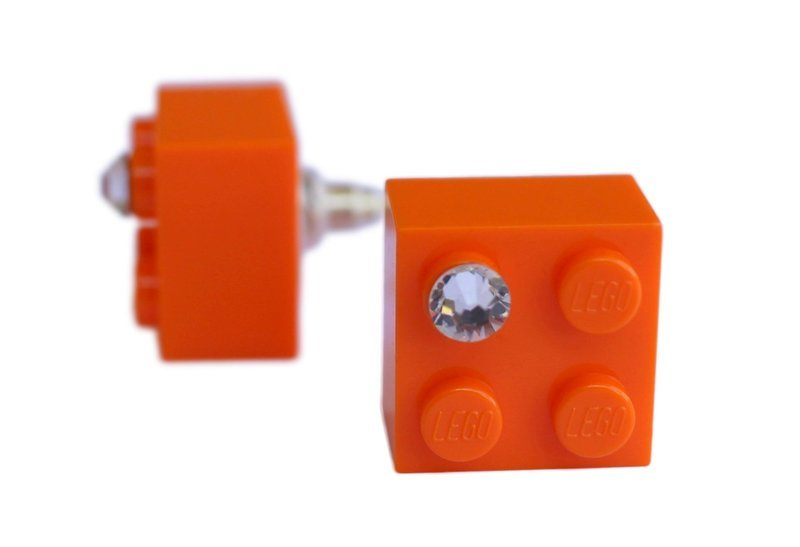 Orange LEGO® brick 2x2 with a 'Diamond' color SWAROVSKI® crystal on a Silver plated stud/silicone back stopper