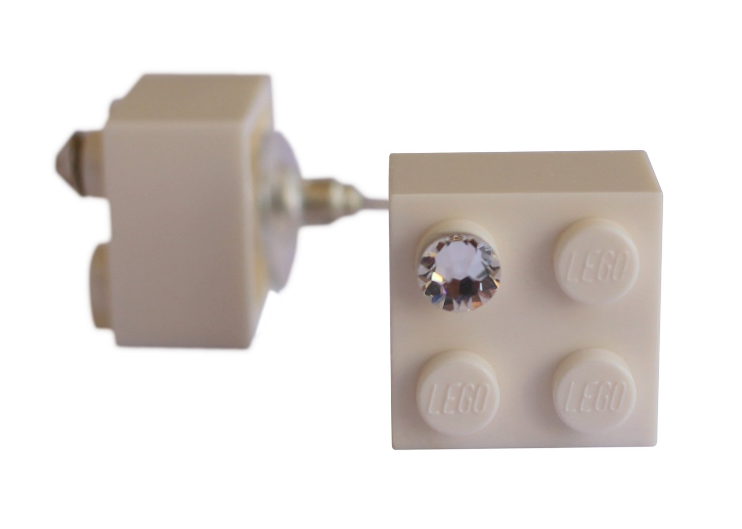 White LEGO® brick 2x2 with a 'Diamond' color SWAROVSKI® crystal on a Silver plated stud/silicone back stopper